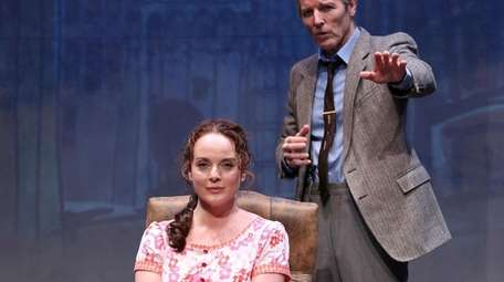 Melissa Errico is hypnotized by Stephen Bogardus, who