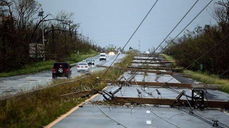 Concrete power line poles lies on a highway