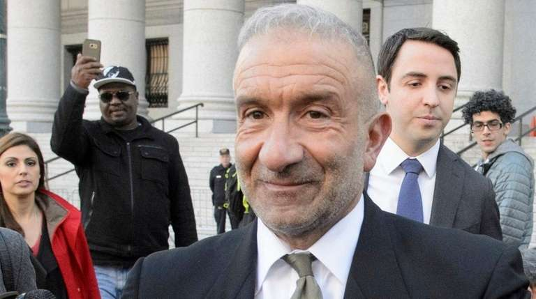 Alain Kaloyeros, center, exits a federal courthouse