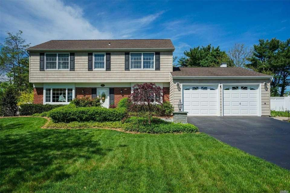 This South Setauket Colonial includes four bedrooms and