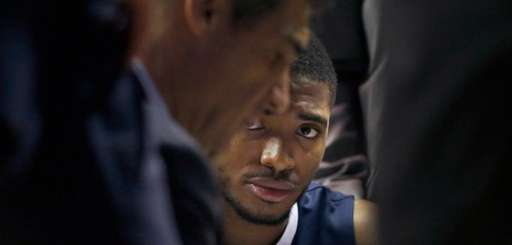 Villanova's Mikal Bridges listens to head coach Jay