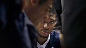 Villanova's Mikal Bridges listens to head coach Jay
