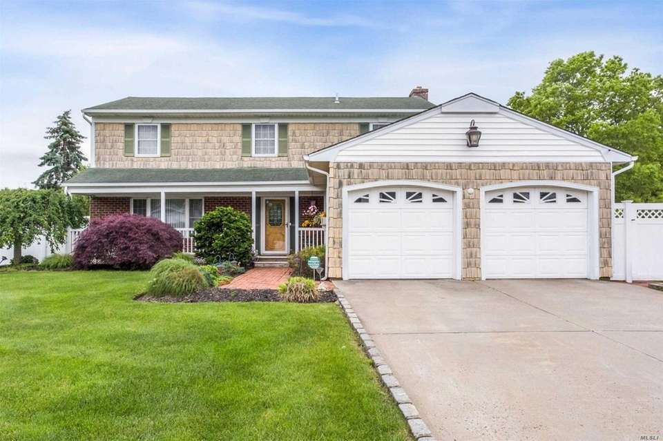 This Holbrook Colonial includes four bedrooms and 2