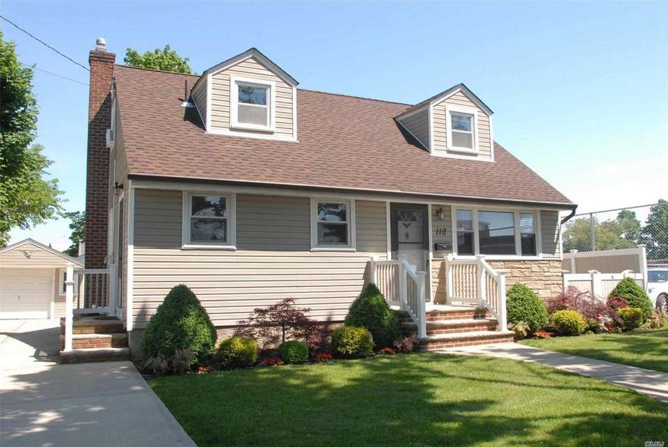 This Floral Park Cape includes three bedrooms and