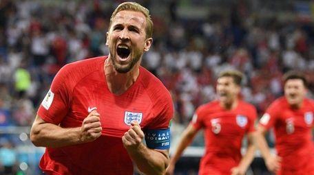 Harry Kane of England celebrates after scoring his