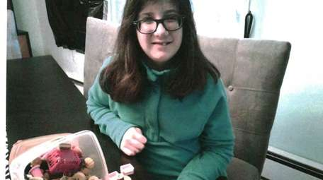 Kidsday reporter Aurora Ryan with her eraser collection.