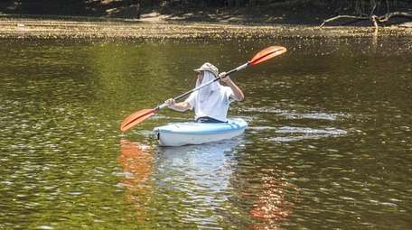 Paul Masciello of Holtsville paddles along the Peconic