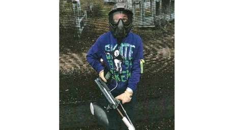 Kidsday reporter Corey Fischer with his paintball gear.