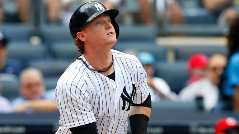 Clint Frazier of the Yankees follows through on