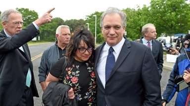 Linda and Edward Mangano outside federal court in