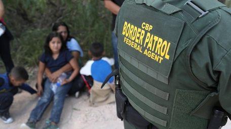 Central American asylum seekers wait as U.S. Border