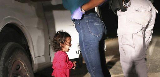 A 2-year-old Honduran asylum seeker cries as her