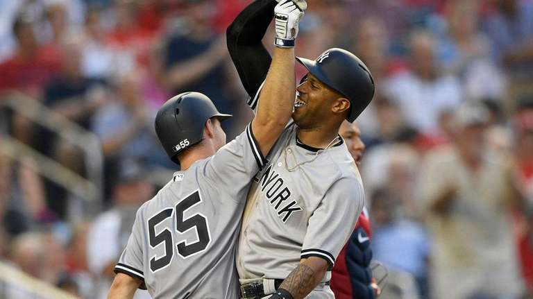 The Yankees' Aaron Hicks, right, celebrates his two-run