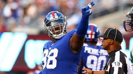 Damon Harrison of the Giants signals after a