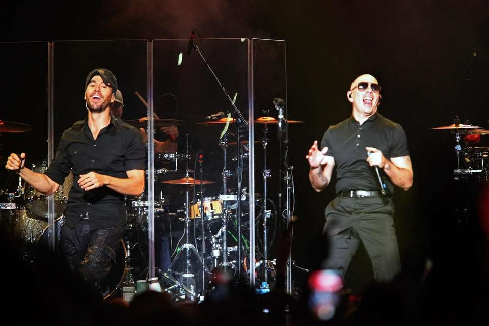 Enrique Iglesias performs with Pitbull, who made a