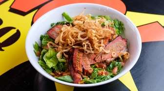 Dang BBQ's excellent brisket is featured, along with