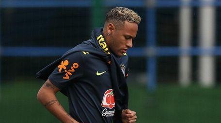 Neymar Jr runs during a training session at