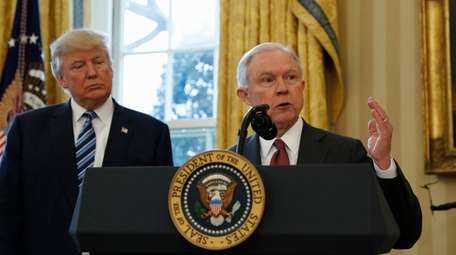 President Donald Trump listens as Attorney General Jeff