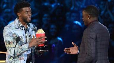 Chadwick Boseman, left, gives his best hero award