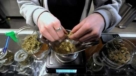 C-4 marijuana is weighed at the Greener Crossing
