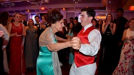 "Physics teacher Audrey ""Doc"" Hebling dances to the"