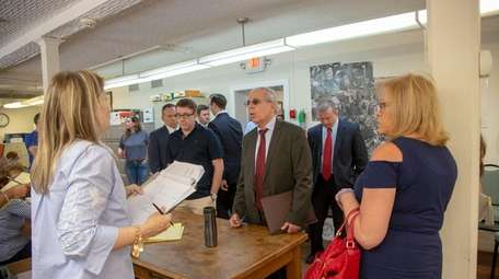 Members of the Nassau district attorney's office visit