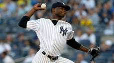 Domingo German of the Yankees pitches in the