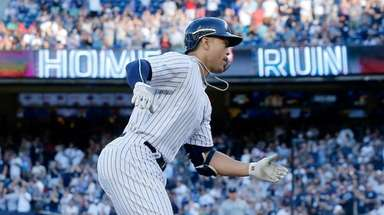 Giancarlo Stanton of the Yankees runs the bases