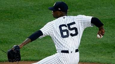 Yankees pitcher Domingo German delivers in the fourth