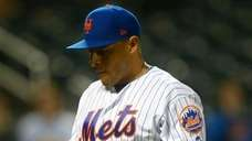 Mets pitcher AJ Ramos walks to the dugout