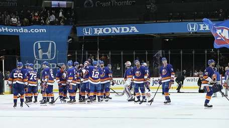 The Islanders acknoledge their fans after their 5-4
