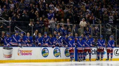 The New York Rangers bench looks on prior