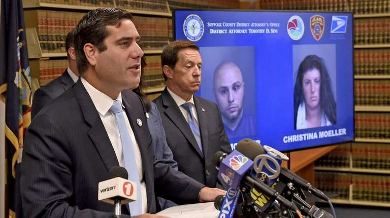 Suffolk County District Attorney Timothy Sini, left, at