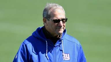 Giants general manager Dave Gettleman walks off the