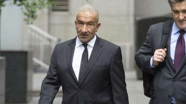 Former SUNY official Alain Kaloyeros, left, arrives at