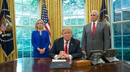 President Donald Trump with Homeland Security Secretary Kirstjen