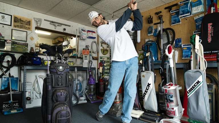 Timothy Rodgers, owner of A-Merrick-A Vac, swings a