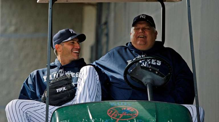Yankees pitcher Andy Pettitte, left, shares a laugh