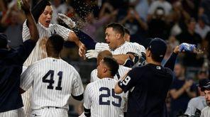 The Yankees' Giancarlo Stanton celebrates his walk-off two-run