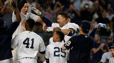 The Yankees' Giancarlo Stanton celebrates his walk-off two-run