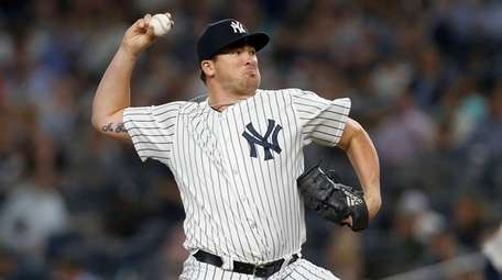 Yankees pitcher Jonathan Holder delivers in the sixth