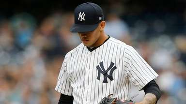 Yankees pitcher Jonathan Loaisiga stands on the mound