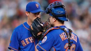 Seth Lugo confers with Devin Mesoraco during the