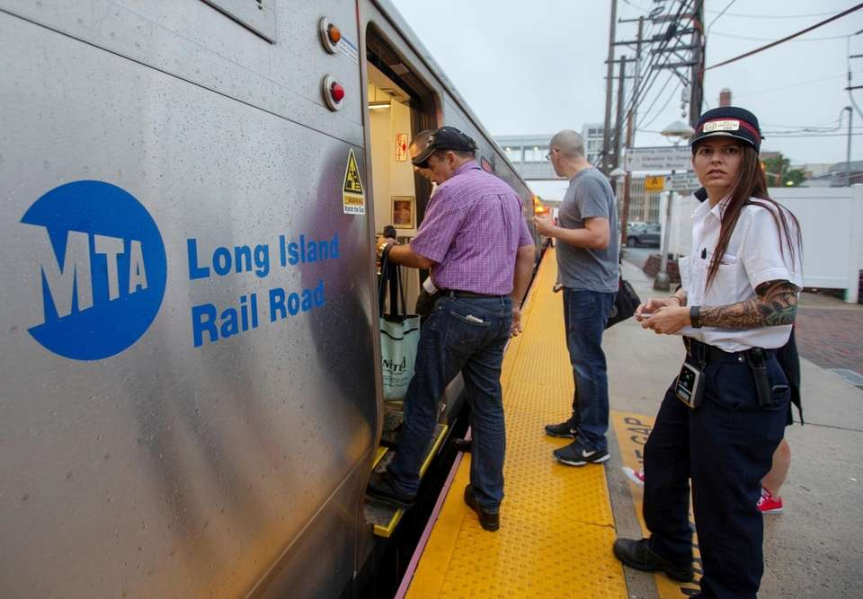 Commuters board the train at the Long Island