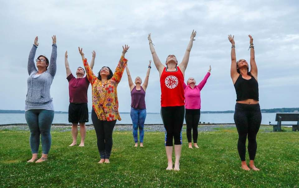 Yogis from the Giving Room embrace the summer
