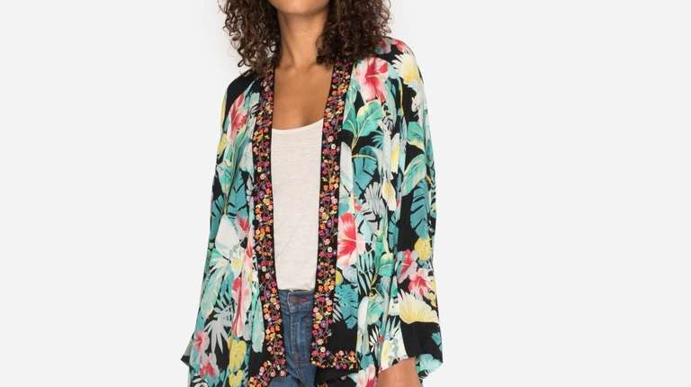 Big, bold flowers meet colorful embroidery on this
