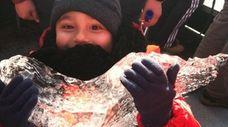 Kidsday reporter Corey Fischer holds a piece of