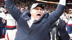 Head coach Barry Trotz of the Capitals hoists