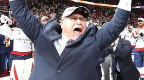 Head coach Barry Trotz of the Capitals hoists