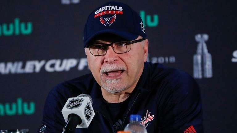 Capitals head coach Barry Trotz speaks while answering